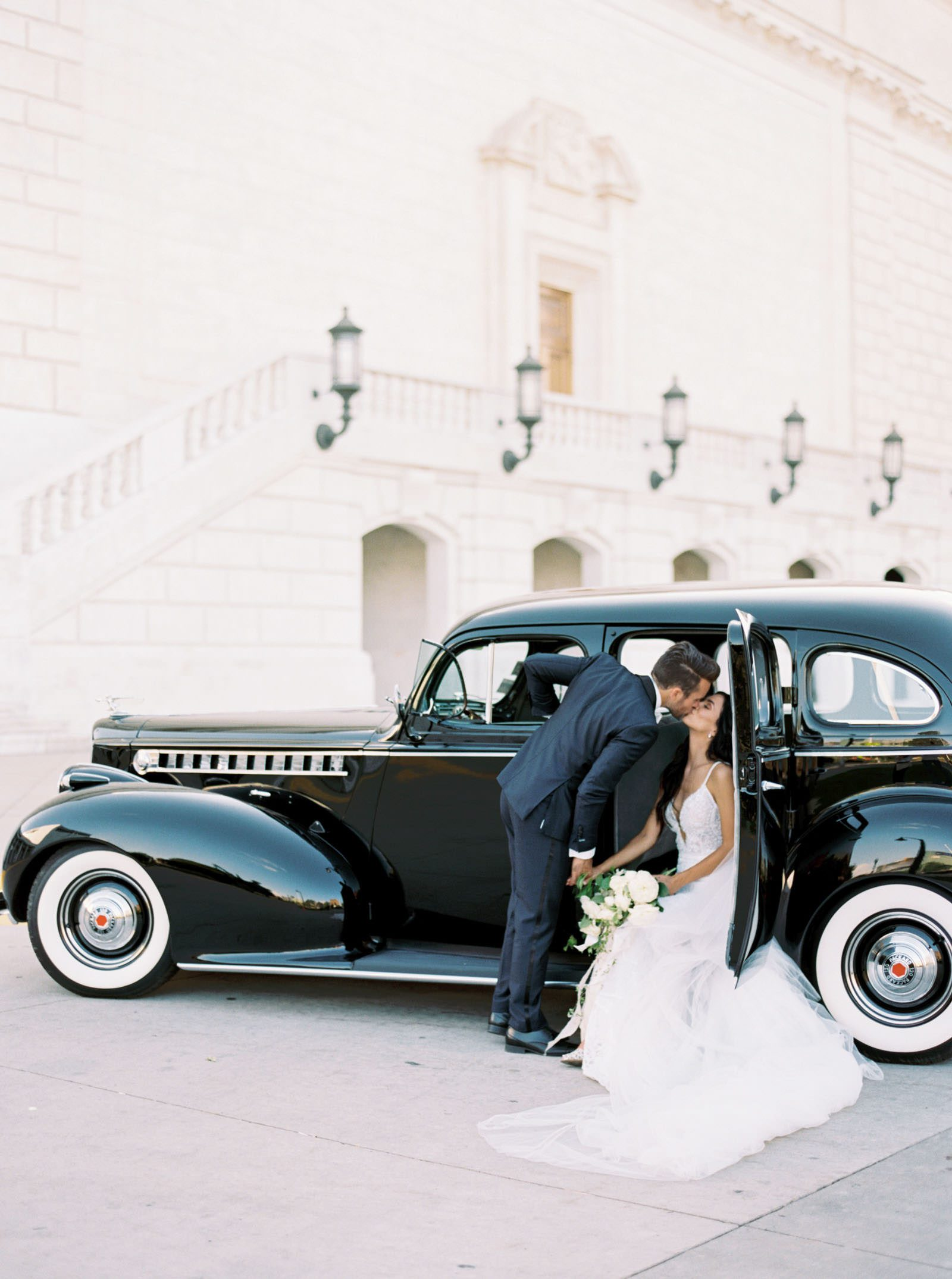 Wedding photos at the Detroit institute of arts with classic car